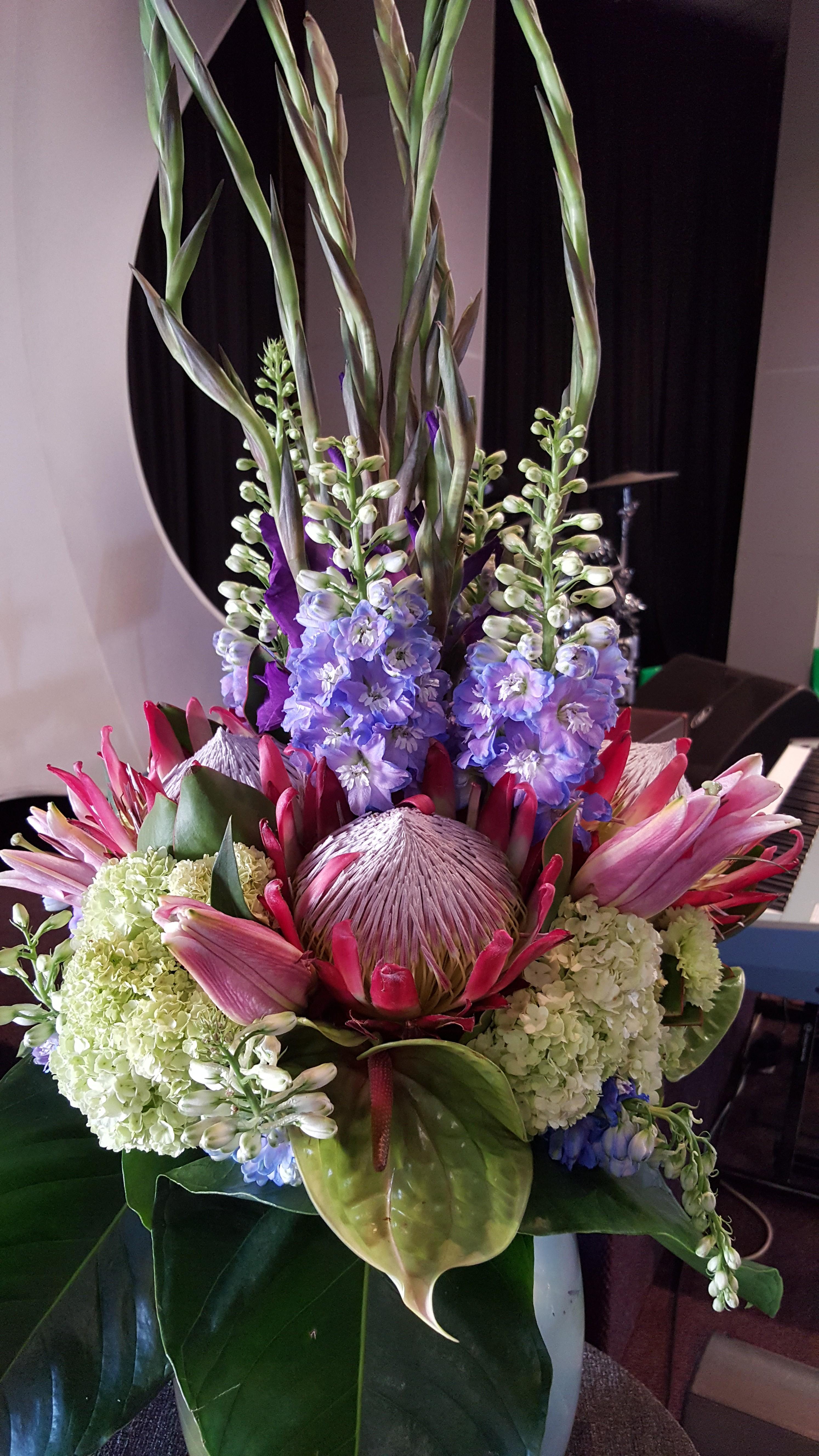 Large upright flower arrangement using king protea s for King protea flower arrangements
